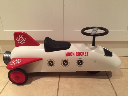 White and red retro moon rocket