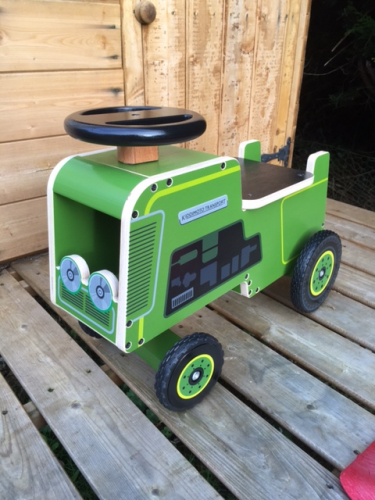 green Wooden tractor ride on toy