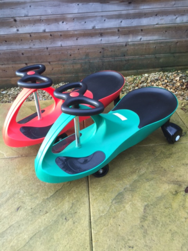 Pair of Diddi Cars ride on toys, one red and one blue