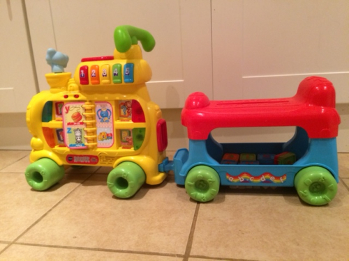 multicoloured Interactive Train ride on toy, with trailer