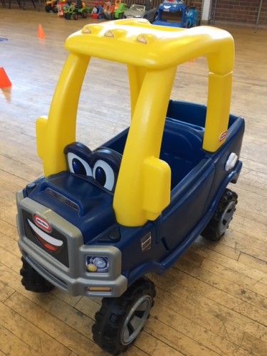 blue and yellow Little Tikes 4 X 4 truck ride on