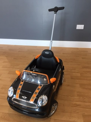 a black mini push-along ride on toy