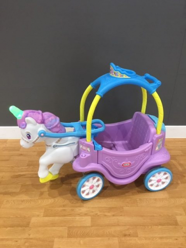 a Unicorn carriage ride on toy
