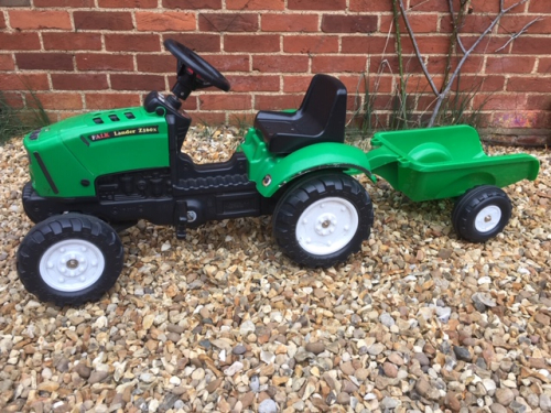 green tractor ride on toy with trailer