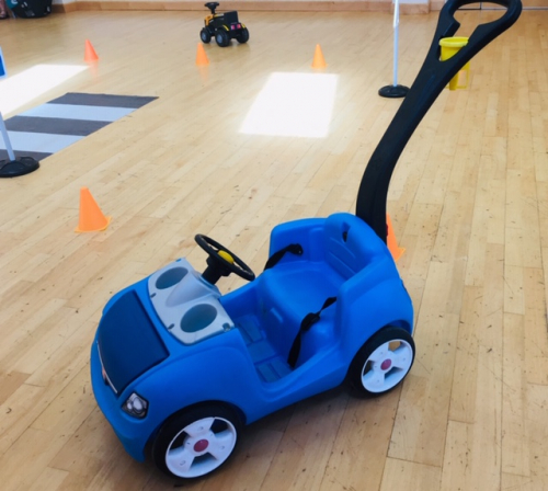 a blue push along ride on toy
